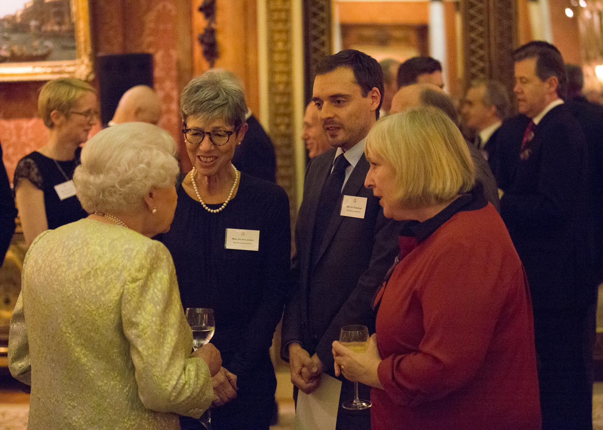 HM Queen Elizabeth II, Joanna Atkin, Guy Parckar and Gill Jepson in conversation.